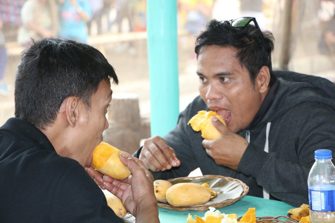 People eating mangoes at Guimaras Manggahan Festival