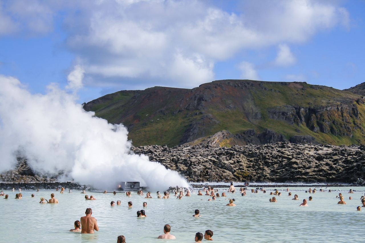 People enjoying the famous Blue Lagoon geothermal spa in Grindavik near Reykjavik