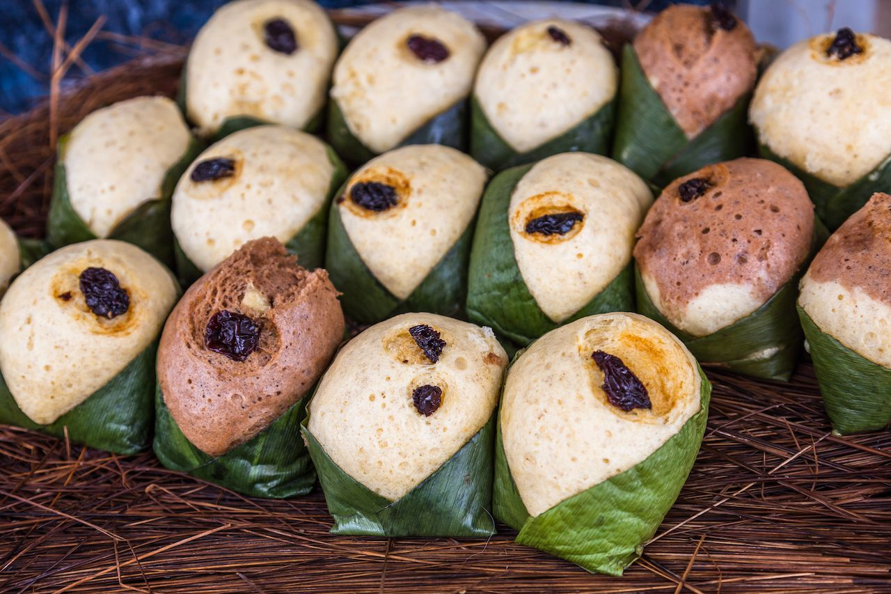 Quimbolitos, cornmeal cakes and wheat; wrapped in a leaf achira