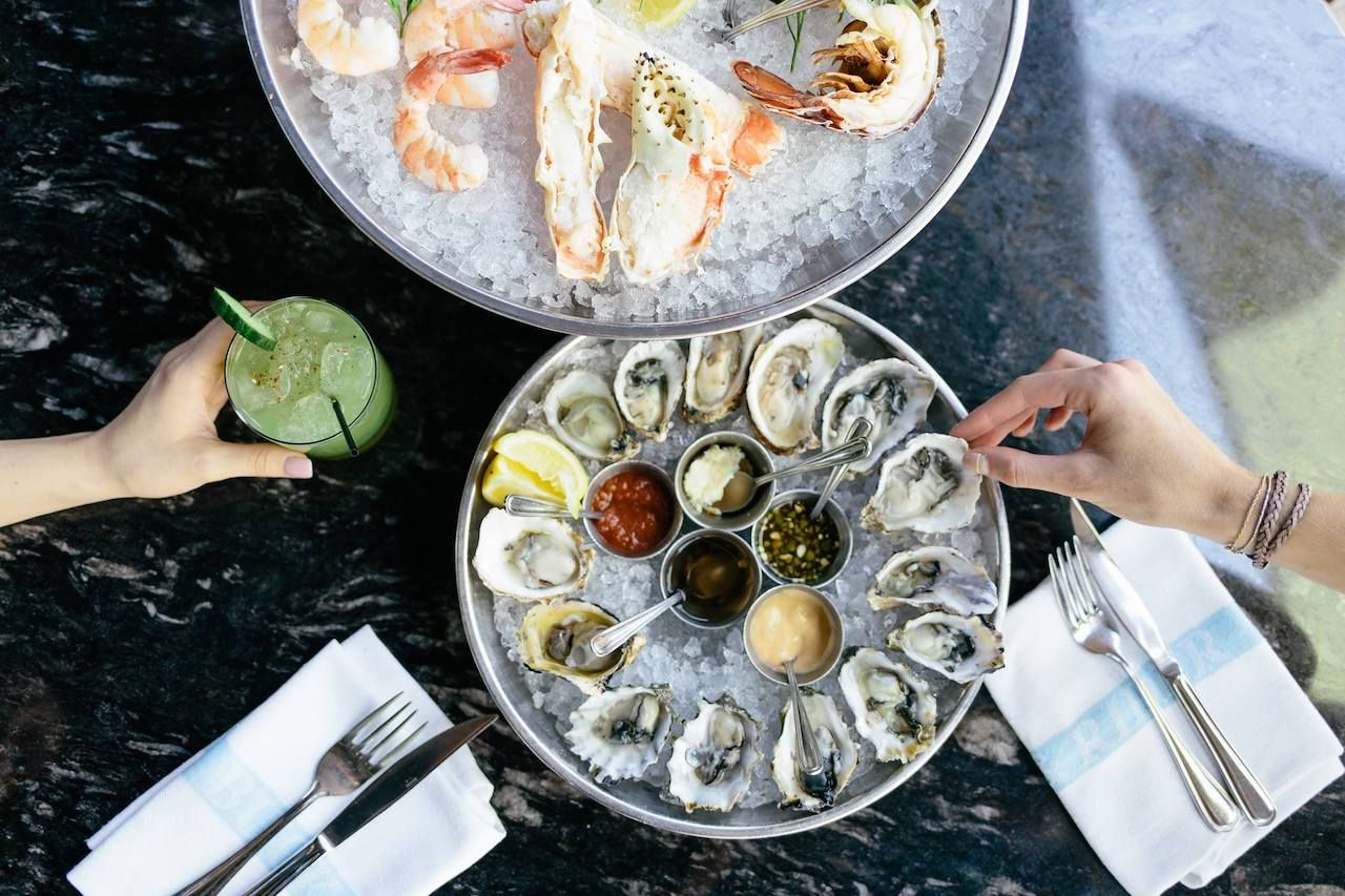Table with oysters and other seafood on ice