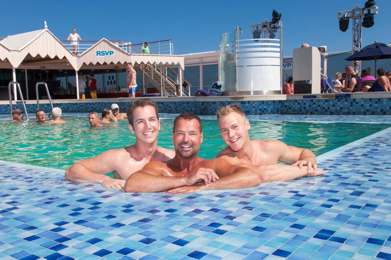Three people in a pool on a RSVP Vacations cruise ship