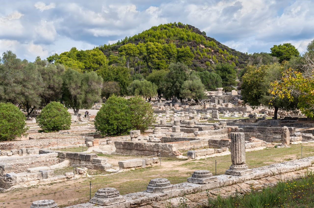 Tourists visiting the ancient Olympia, Peloponnese, Greece