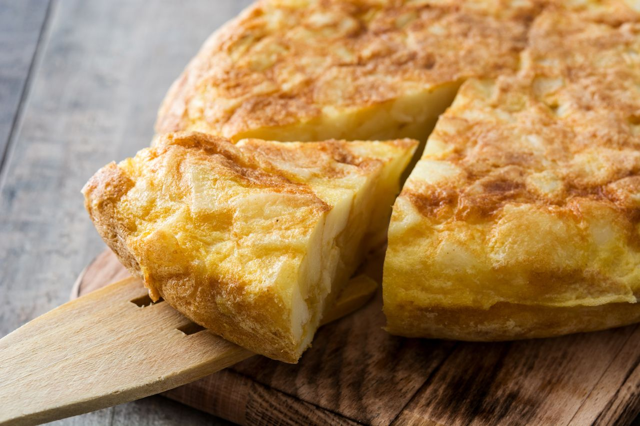 Traditional spanish omelette on wooden table