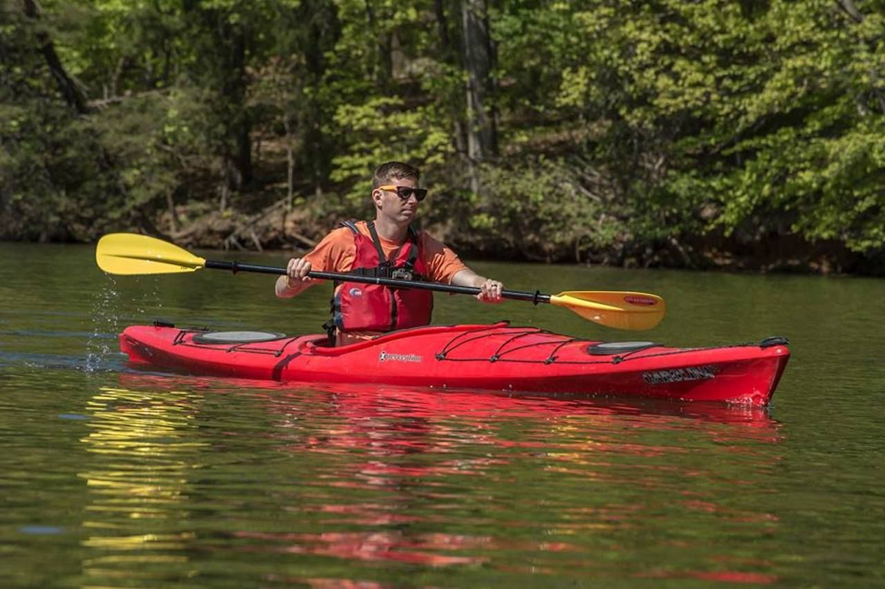 Guy kayaking in Greensboro