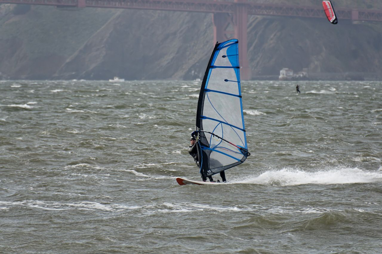 Windsurfer sailing at Crissy Field, Presidio National Park, San Francisco Bay
