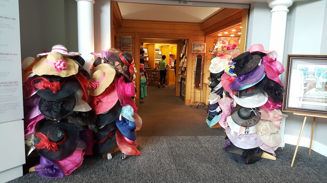 fancy women's hats on display at the Kentucky Derby Gift Shop Museum