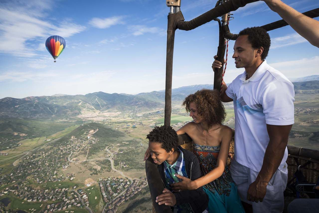 A family enjoying a hot air balloon ride in Park City, Utah.