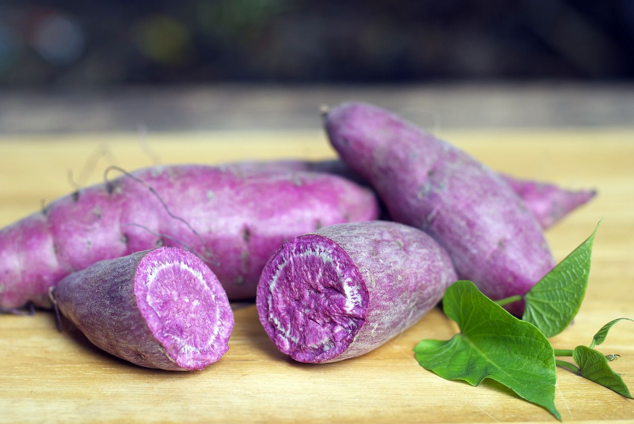 ube, purple sweet potato on wooden background