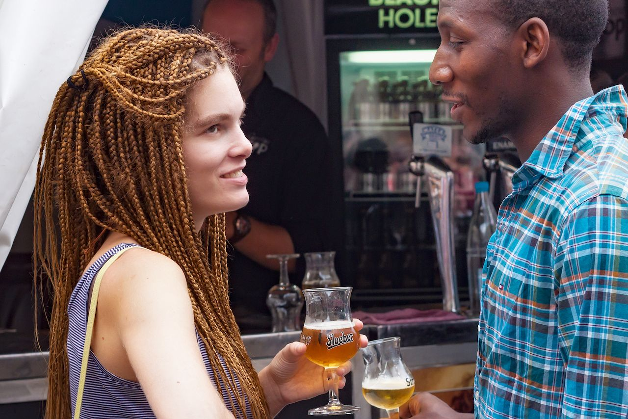 young woman and man with a glass of beer at the festival Belgian Beer Weekend 2014