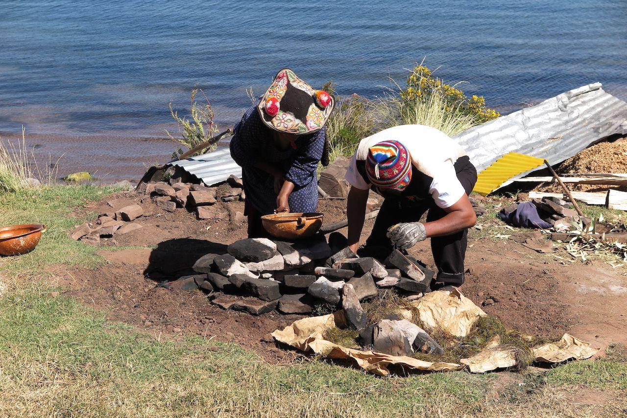 Cooking underground, Lake Titicaca, Peru