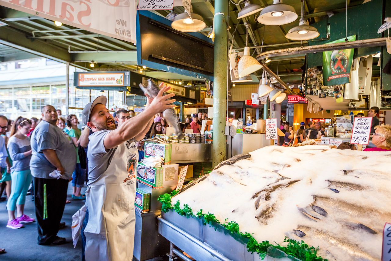 Customers at Pike Place Fish Company wait to order fish