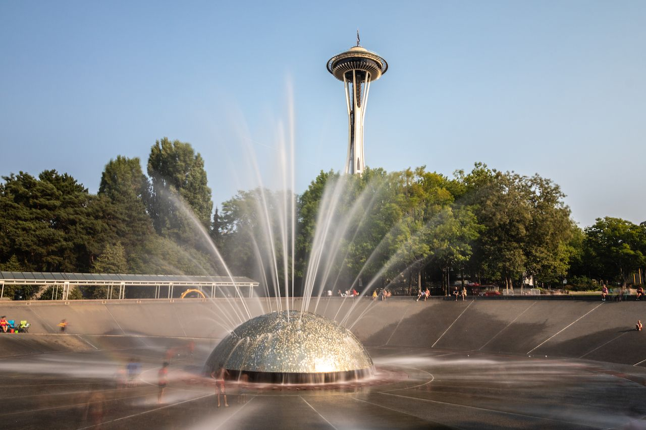 People outside enjoying a warm summer afternoon at the International Fountain in Seattle