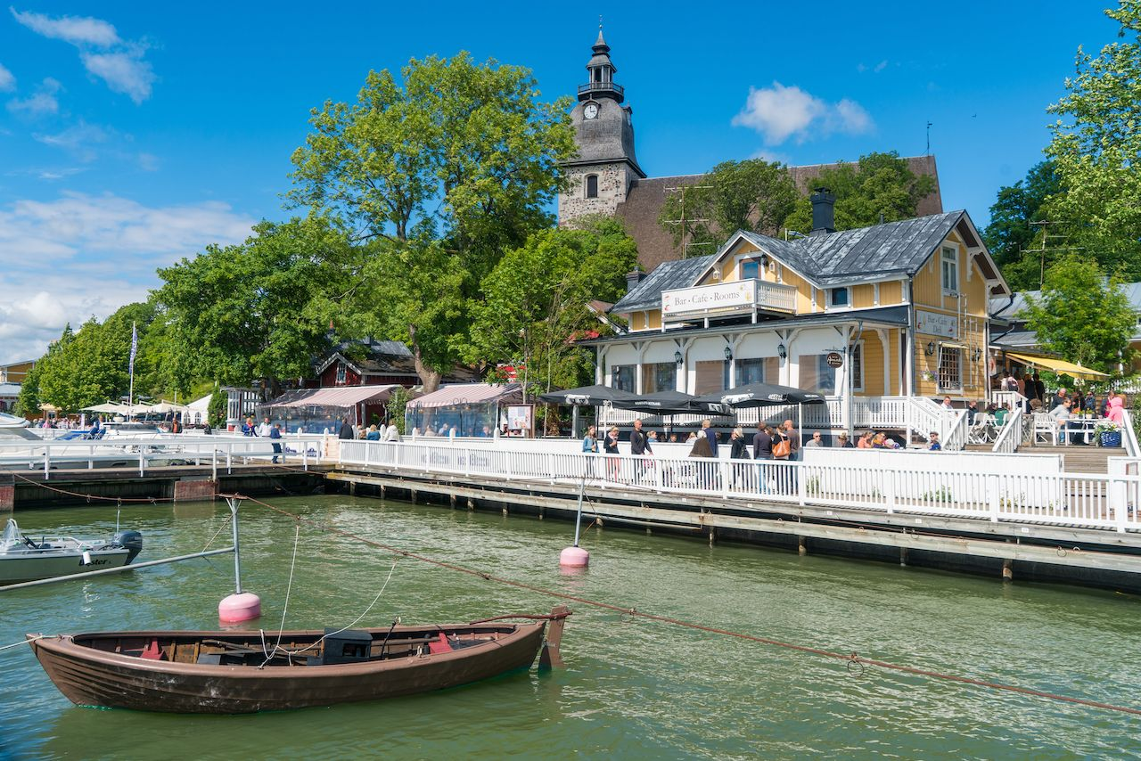 The small boat harbour and Naantali church at sunny summer day