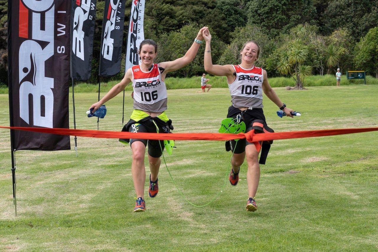 Two people at finish line of Breca Swimrun