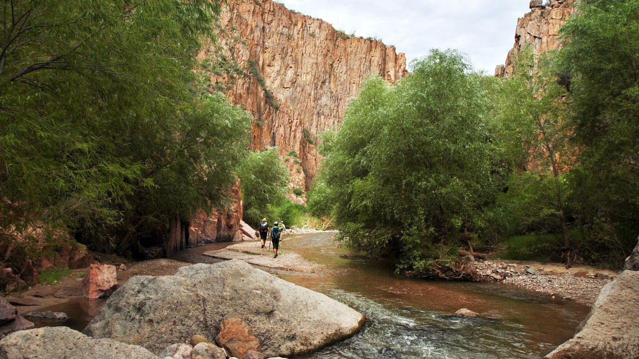 Two people in Aravaipa Canyon