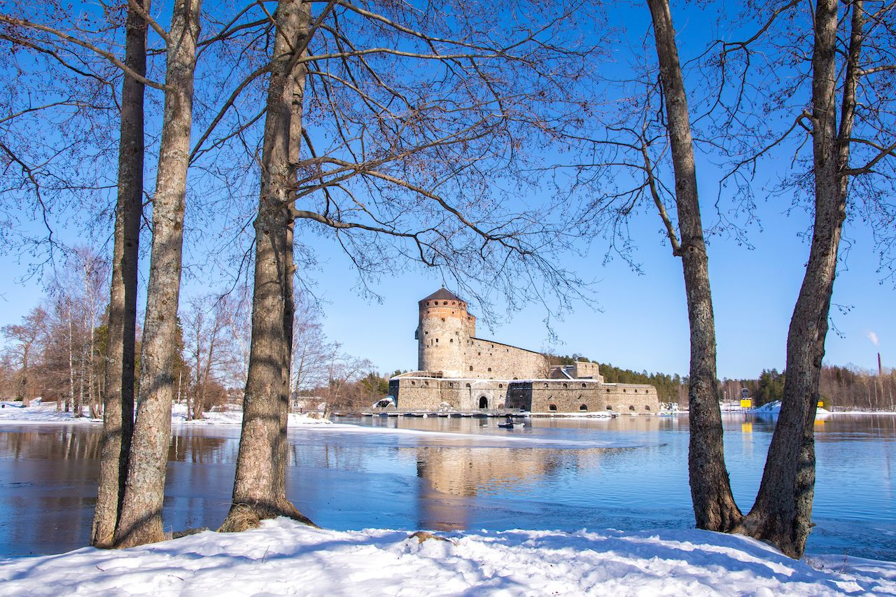View to Olavinlinna Castle and lake from the shore, Savonlinna, Finland