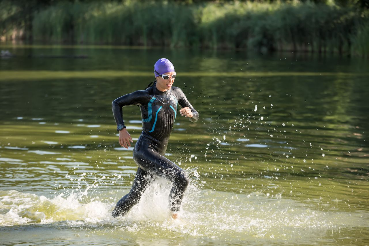 runner runs on the water outdoors