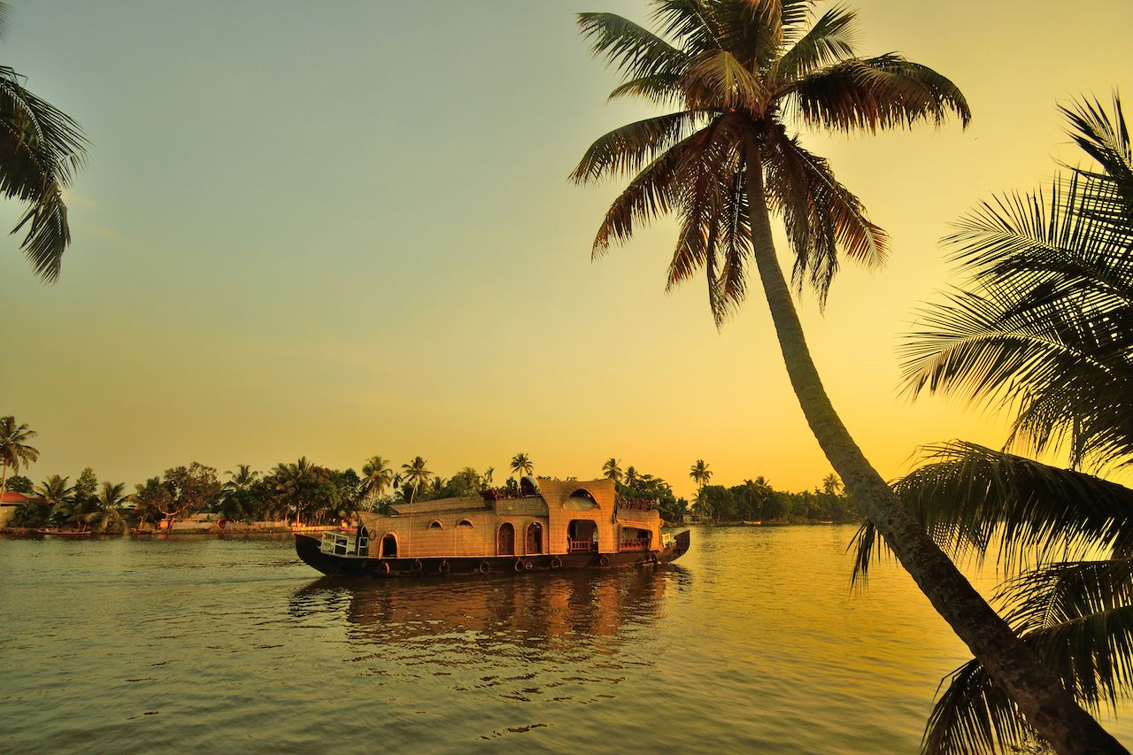 A houseboat sailing in kerala backwaters during sunset