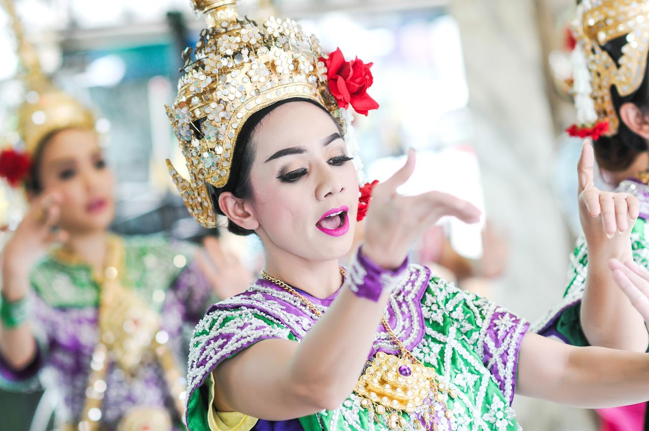A woman dancing to famous Erawan shrine at Ratchaprasong