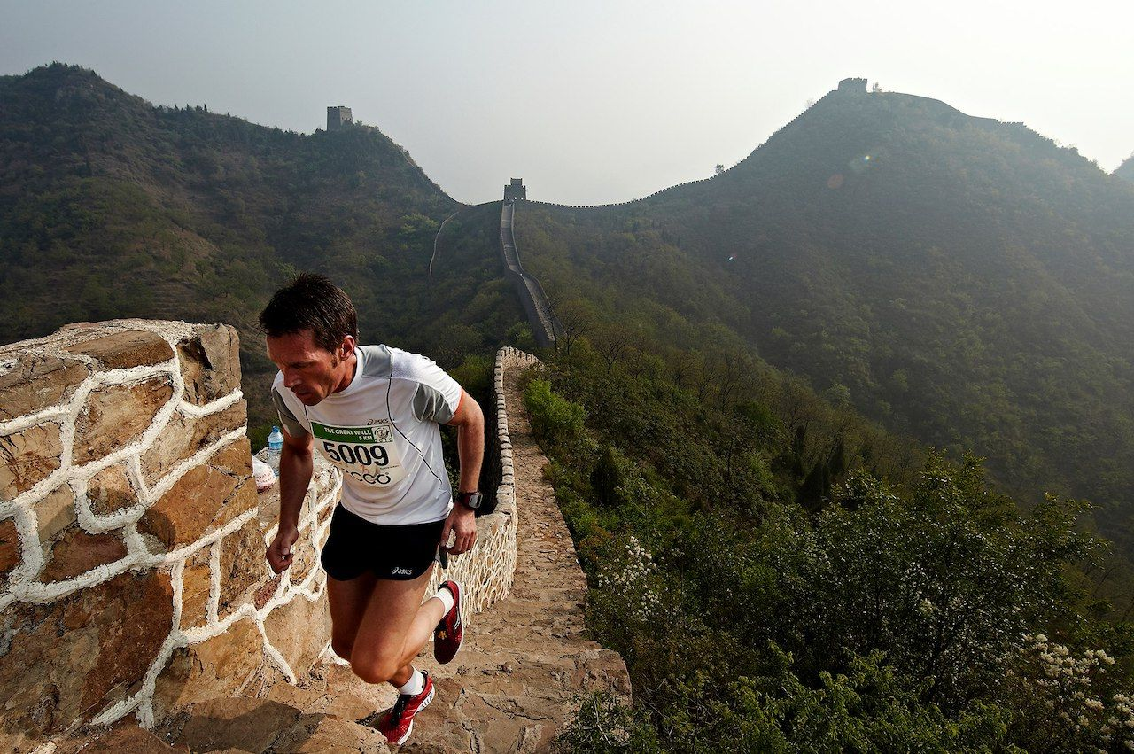 Person running on the Great Wall
