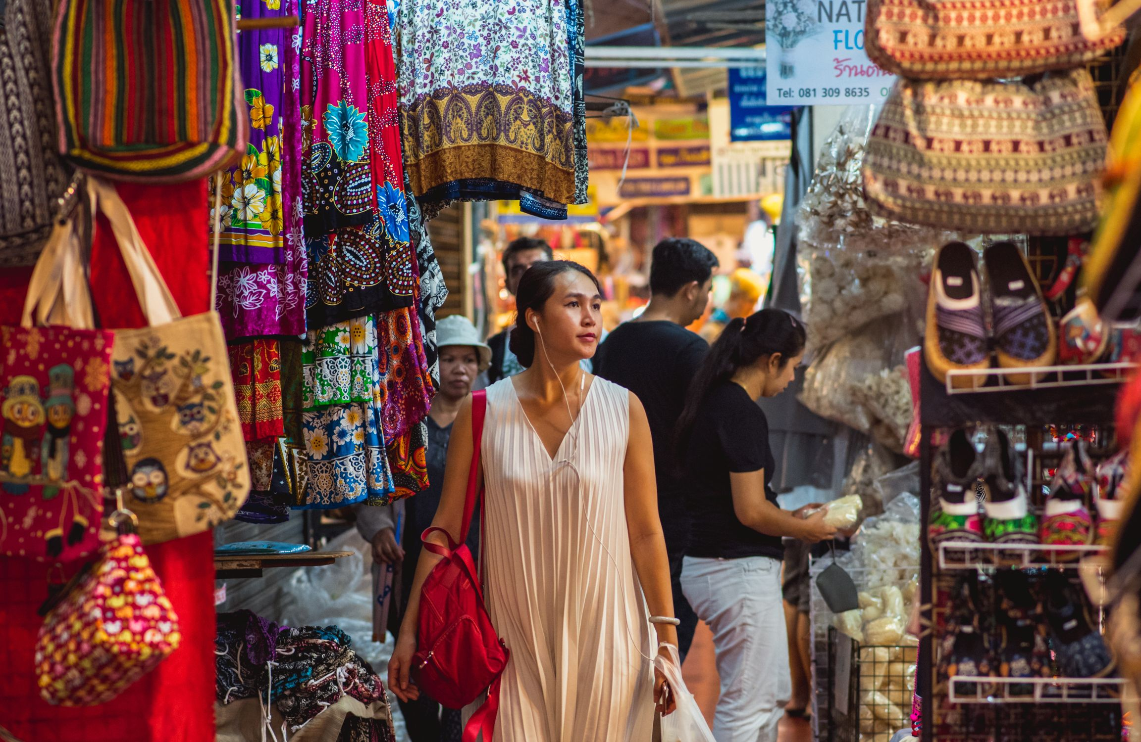 Person walking along stalls and stands of Chatuchak market