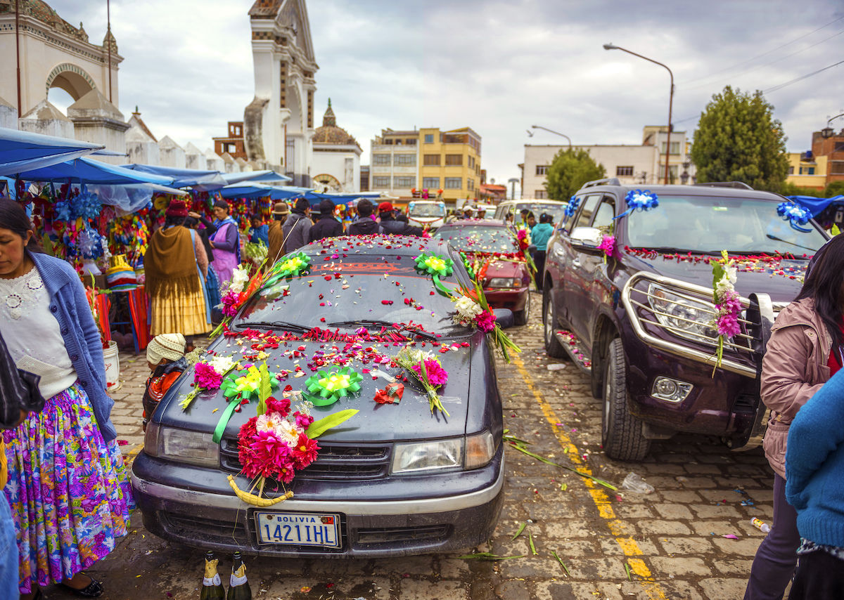 Car blessings, complete with firecrackers and Champagne, are a weekly tradition in Bolivia