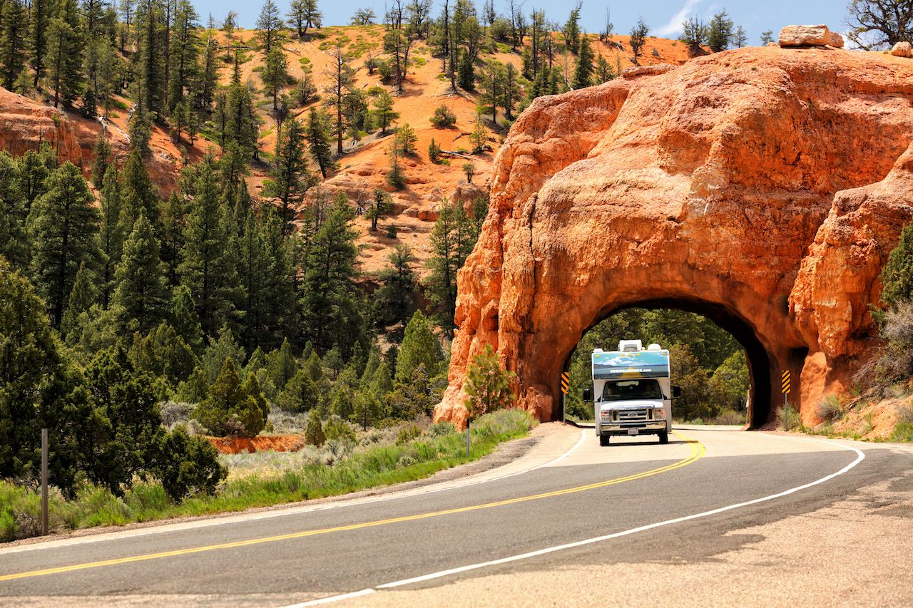 A motor home driving through a tunnel in the red rock area just outside of Bryce Canyon National Park in Utah