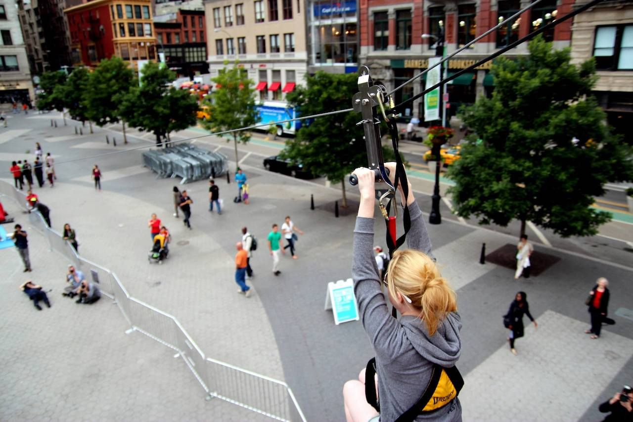 Pedestrians on street, zip line