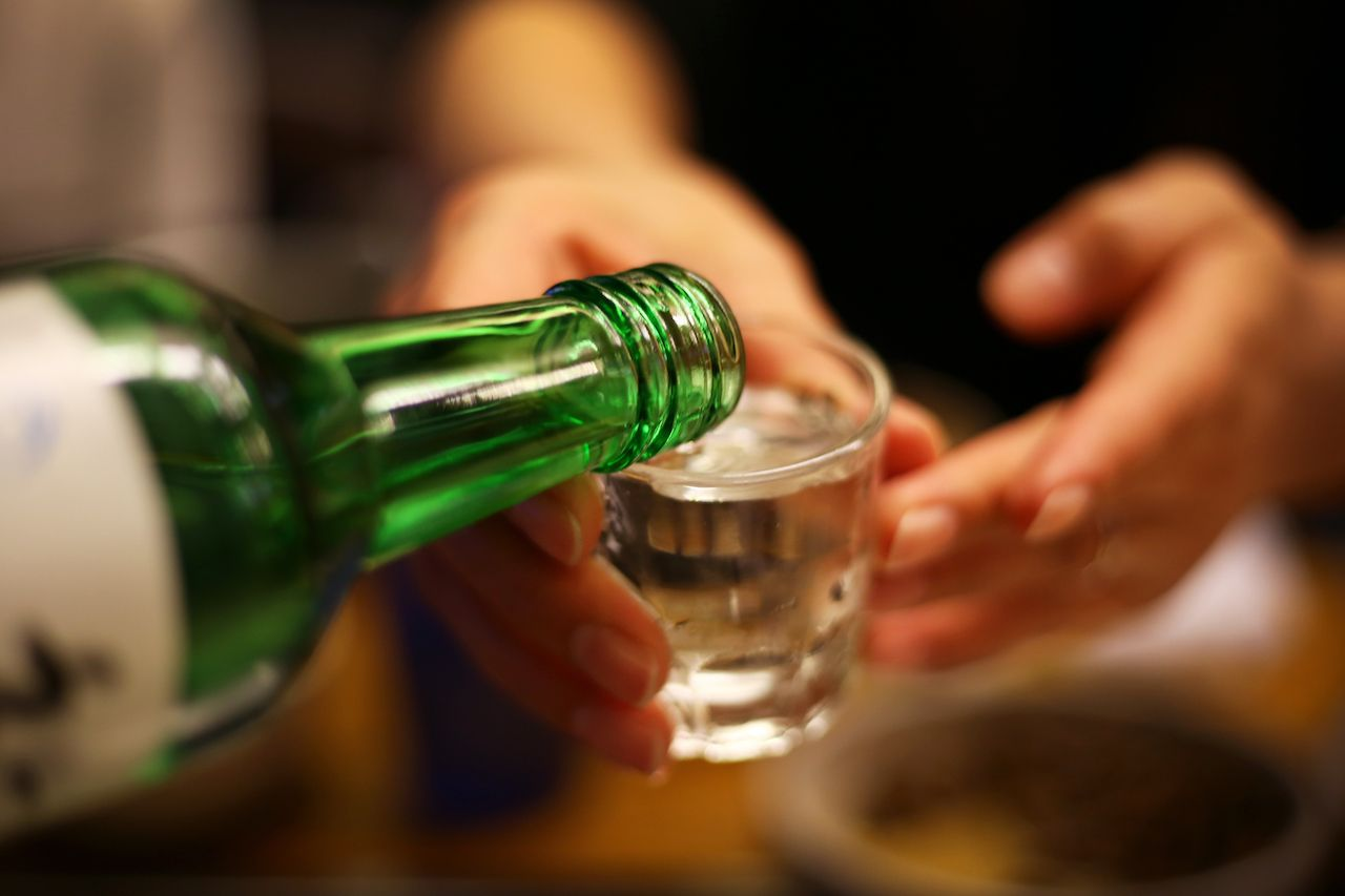 Soju being poured in a glass