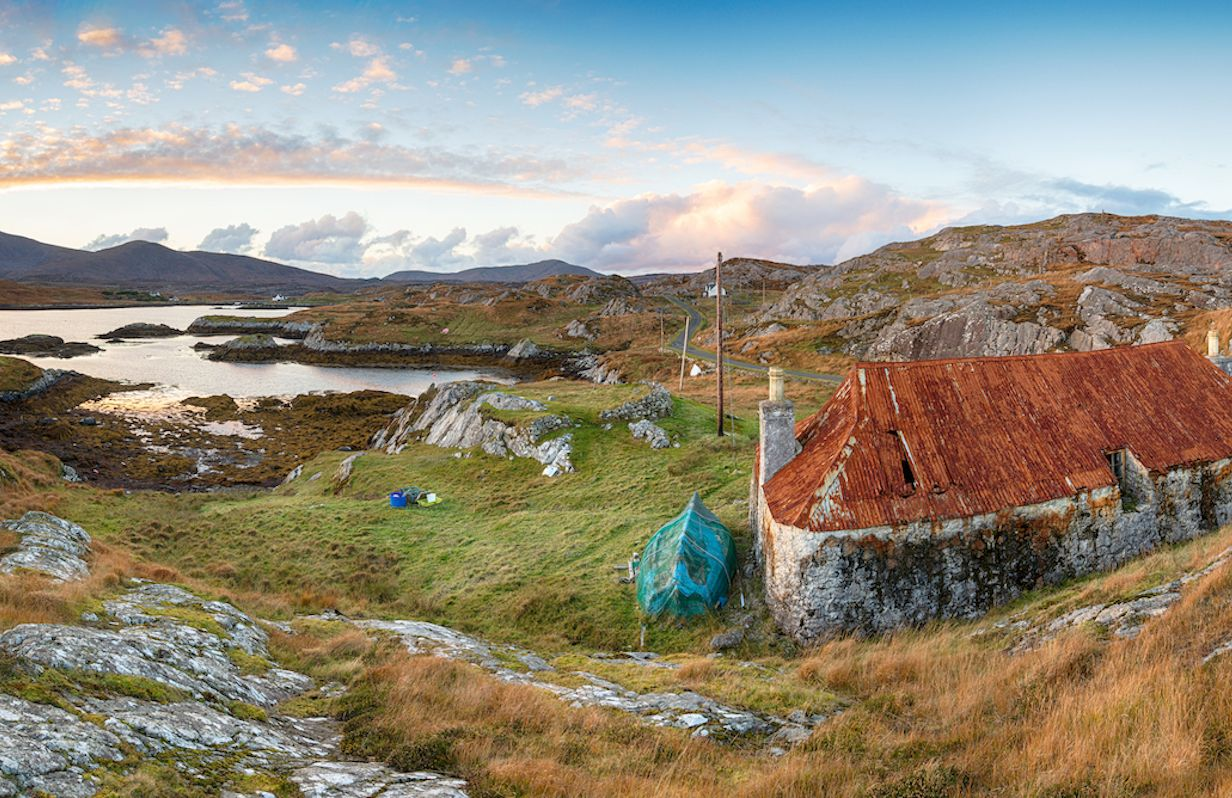 Sunset over an abandoned croft at Quidnish on the Golden Road on the Isle of Harris in the Western Isles of Scotland