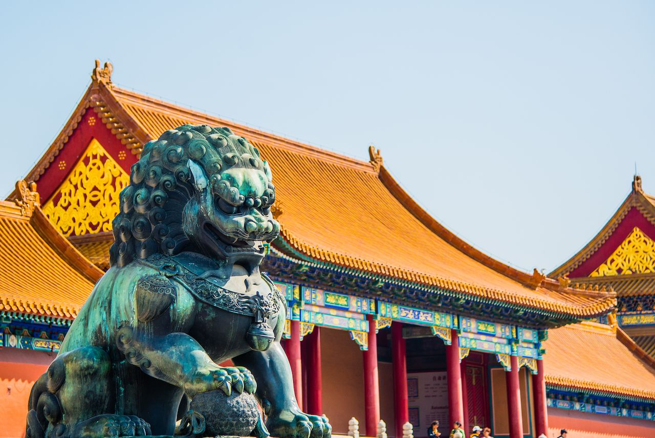 A gilded lion in front of the Hall of Mental Cultivation in forbidden city