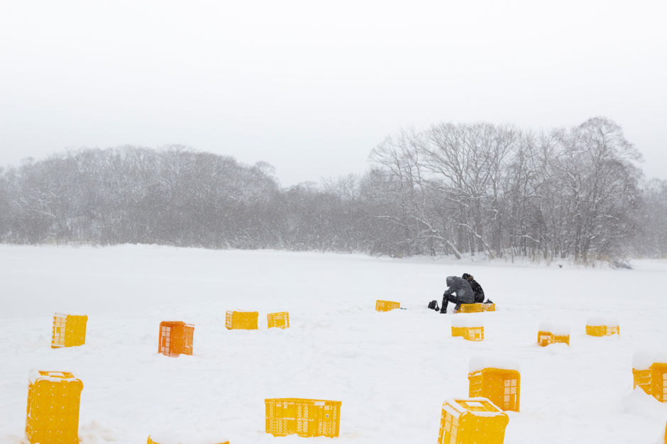 Sapporo,Hokkaido Japan -February 2018 : sweetheart tourists ice fishing on the lake in Hokkaido at japan , landscape; Shutterstock ID 1233991828; Purchase Order: ANA 2019 SP2