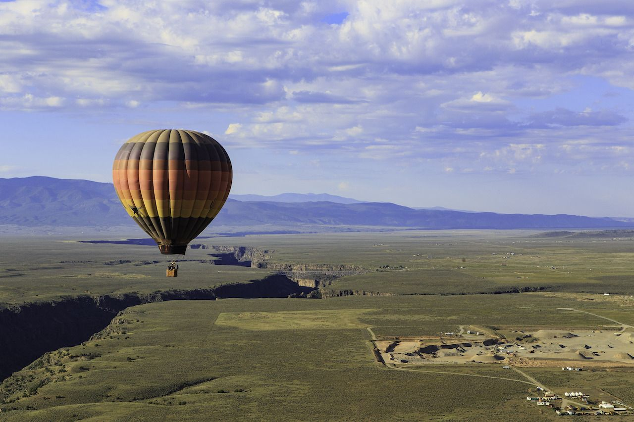Hot air balloon flying over the Rio Grande Gorge, New Mexico