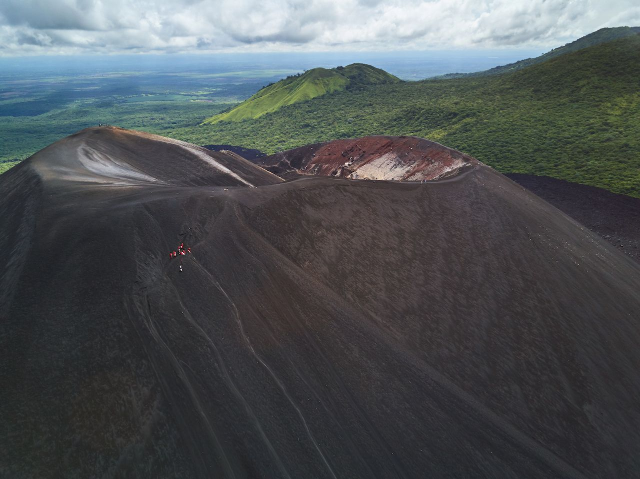 """""""Volcano board"""" your way back down.. The post 4 of the coolest day hikes up volcanoes in Nicaragua appeared first on Matador Network.."""