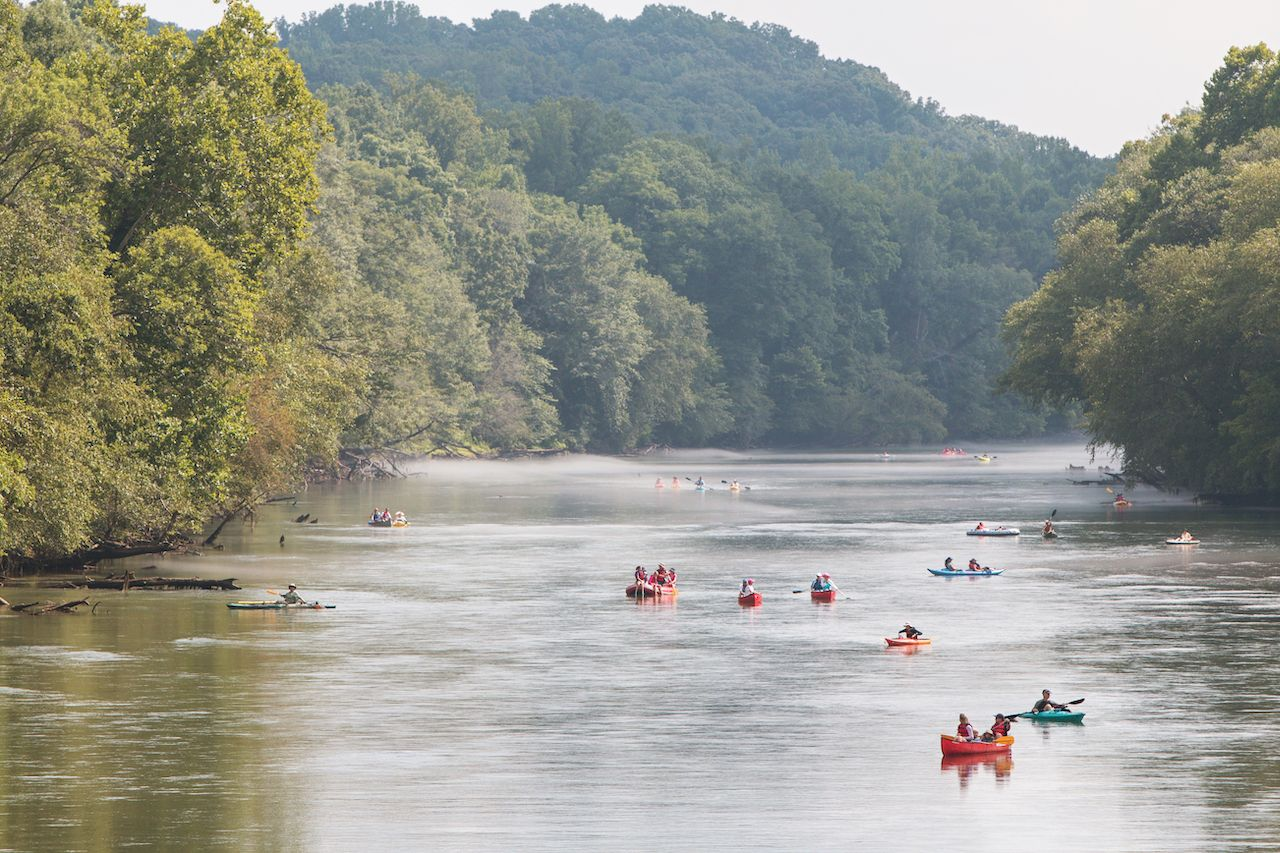 People rafting and kayaking down Chattahoochee River