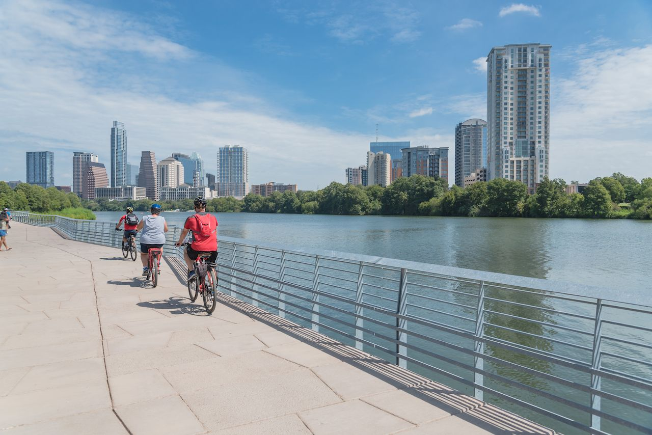 People riding bikes by the water