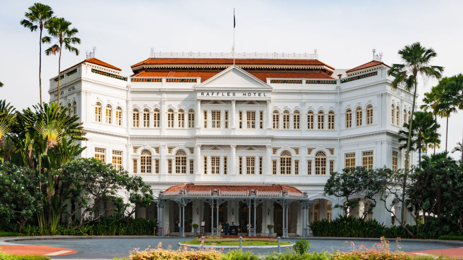 Singapore's luxurious Raffles Hotel is offering anyone a suite for one month, but you'll have to earn it