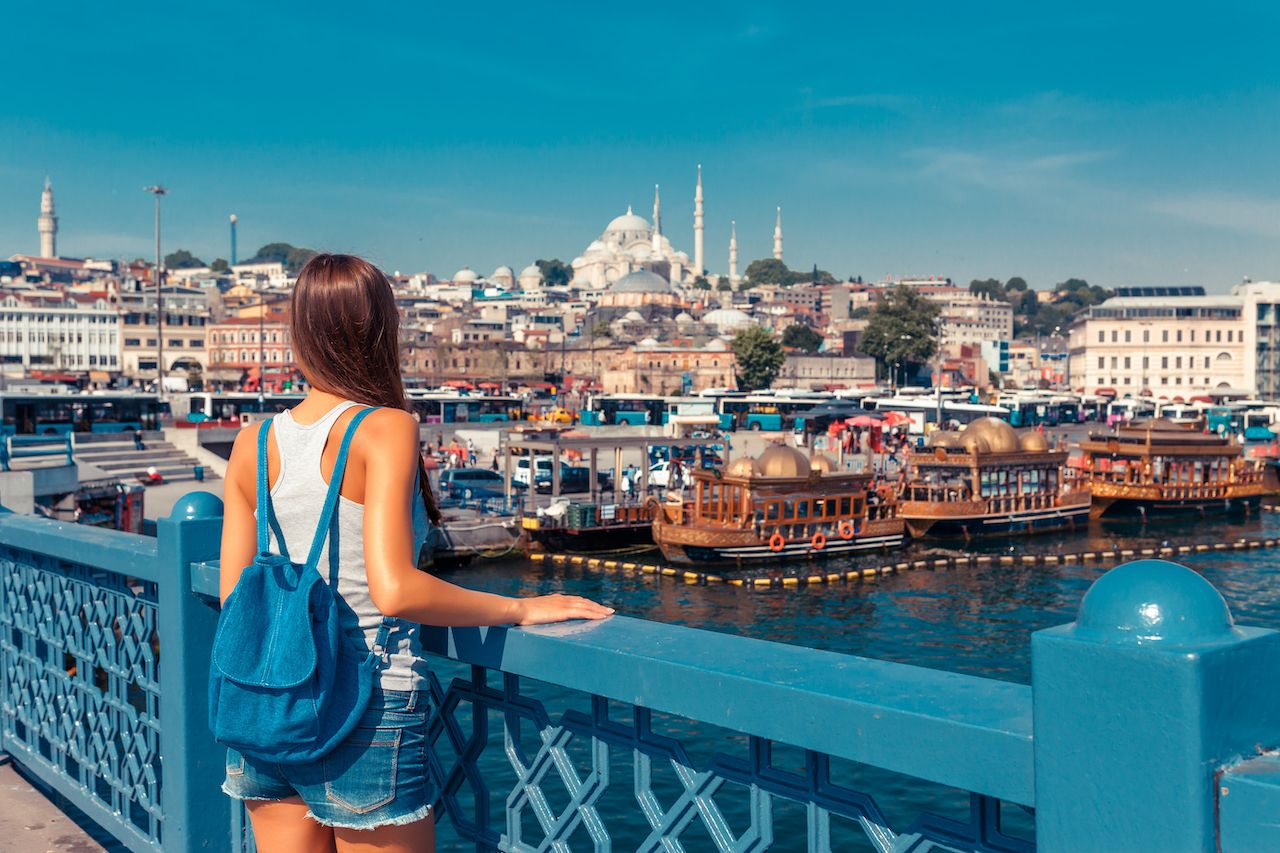 tourist on Galata bridge, Golden Horn bay, Istanbul
