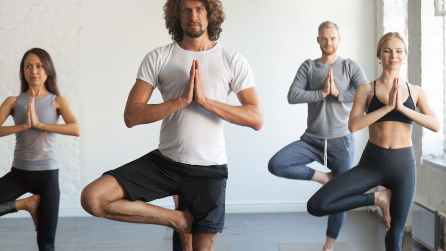 Doing yoga on vacation is more stressful than theme parks, a new study says