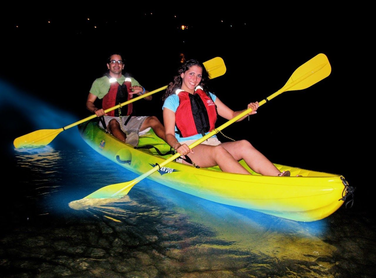 People in a kayak in bioluminescent bay