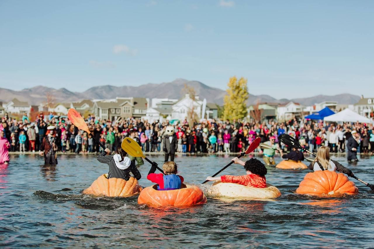 People in pumpkin boats