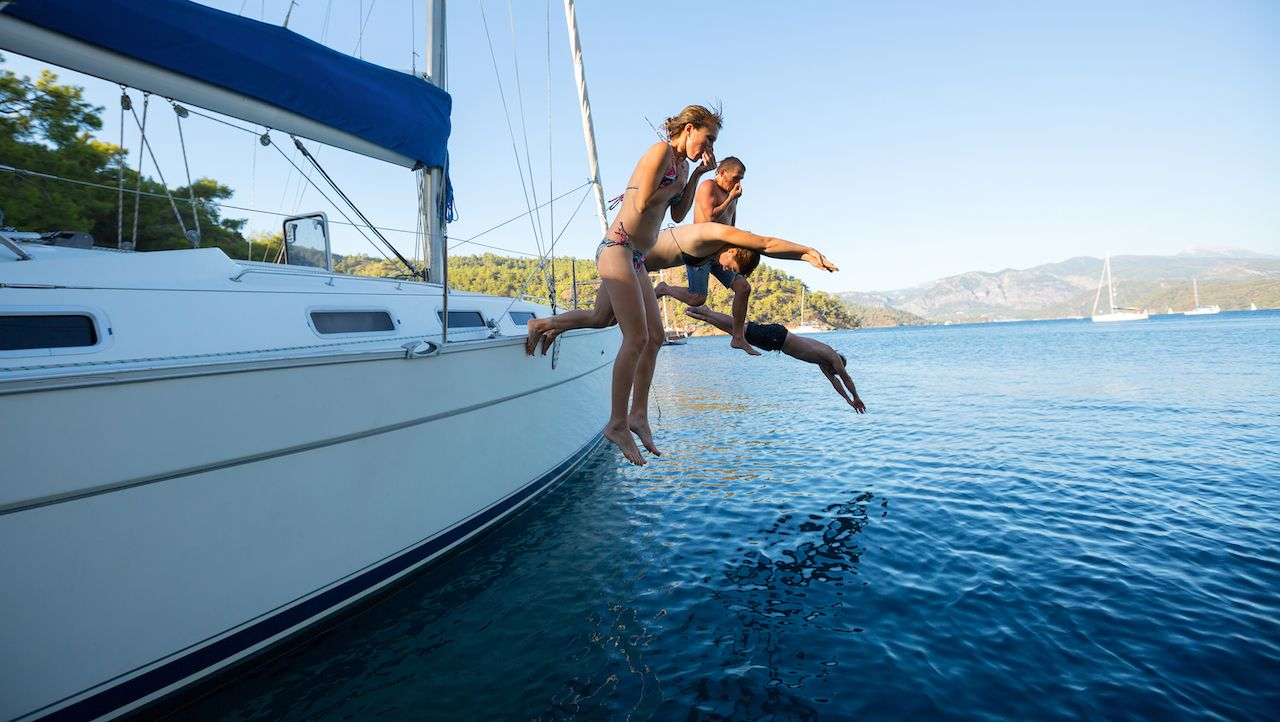 People jumping off boat