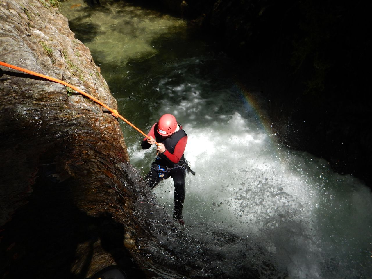 Person rappelling into water