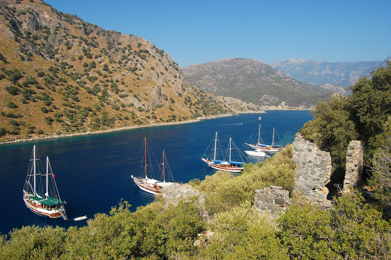 Yachts anchoring near small island on Turkish coast