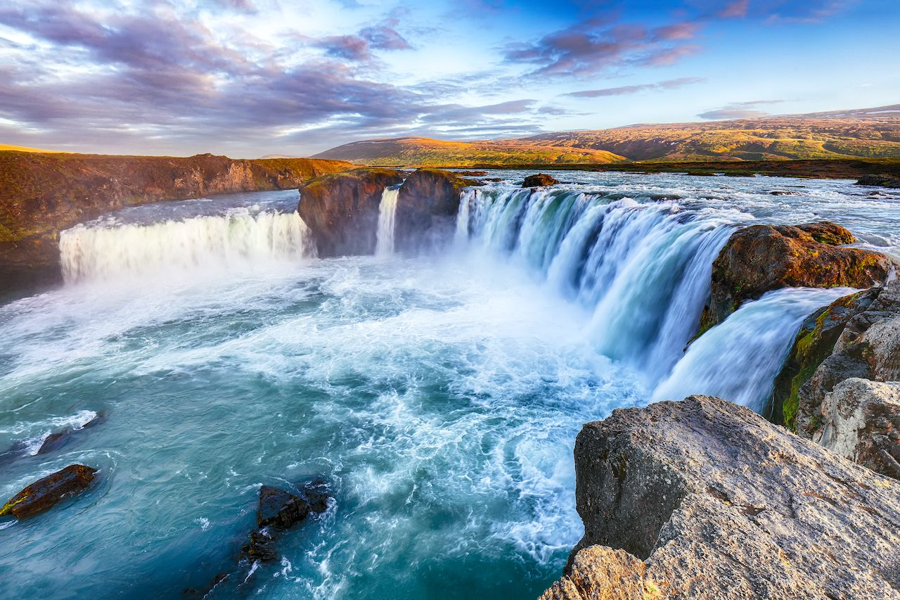 Breathtaking sunset landscape scene of powerful Godafoss waterfall. Dramatic sky over Godafoss. Location: Bardardalur valley, Skjalfandafljot river, Iceland, Europe most instagrammed