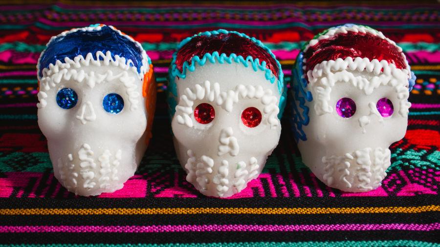 On Dia de los Muertos, sugar skulls represent death through sweetness and nostalgia