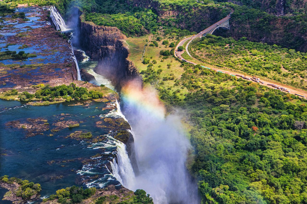 Rainbow over Victoria Falls in Zimbabwe, sunny day in Africa most instagrammed waterfalls
