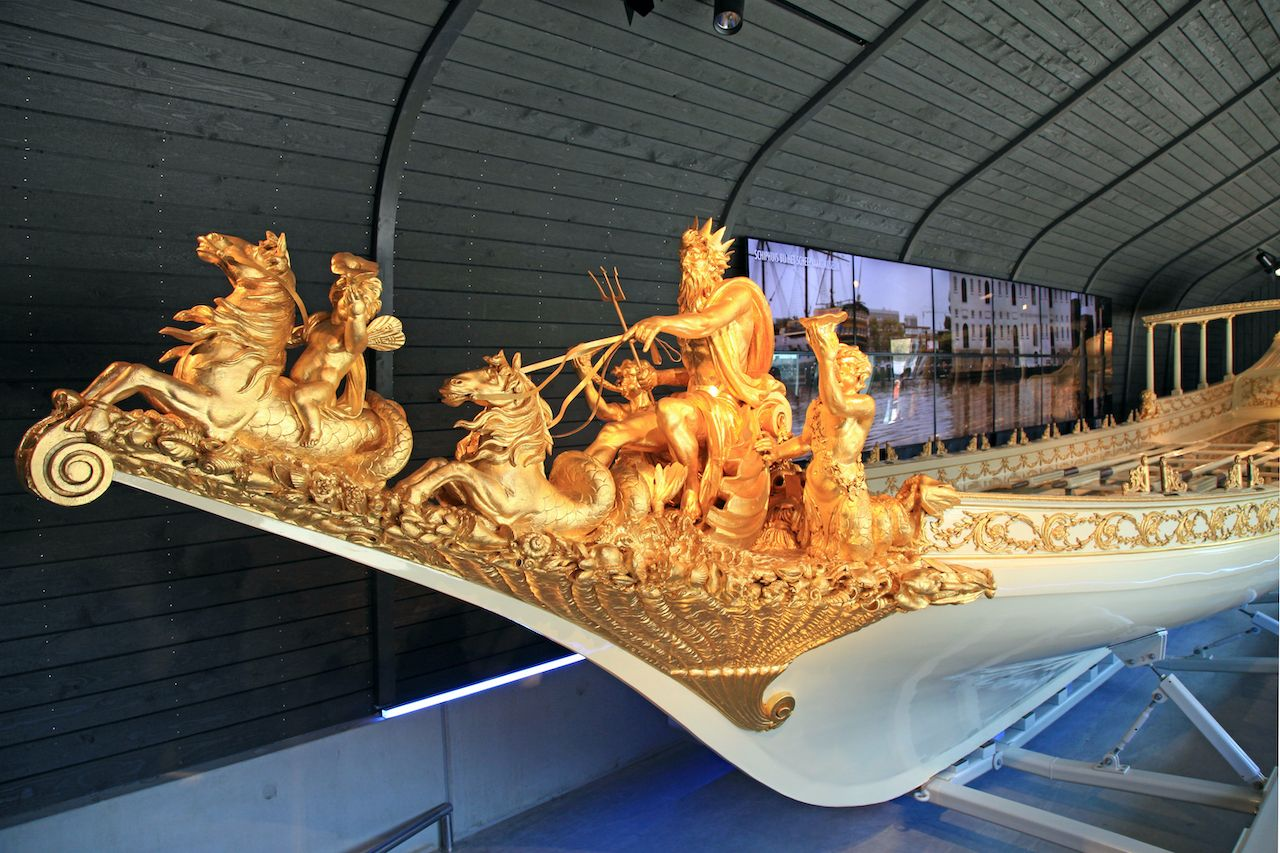 Gold statue on bowsprit of baroque dutch medieval royal boat in The National Maritime Museum