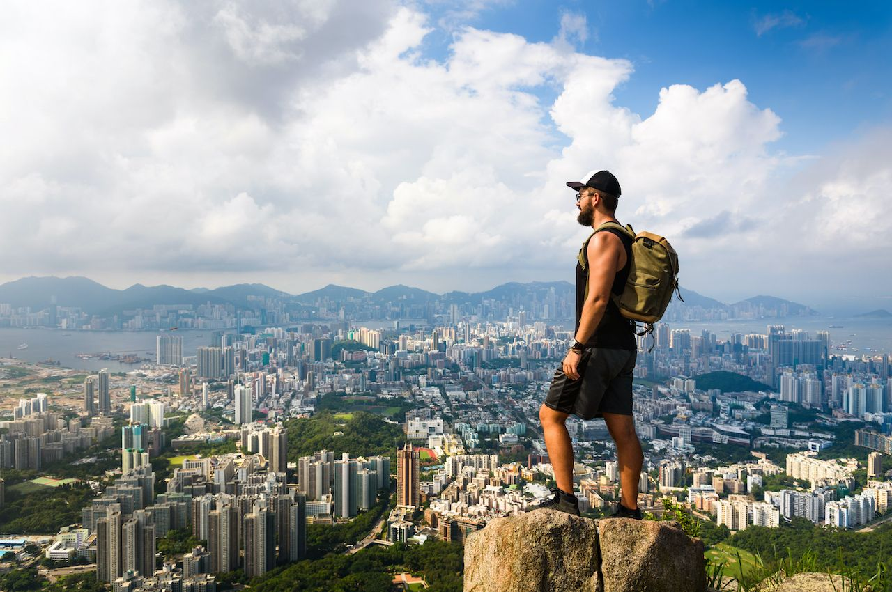 Person looking at view of Hong Kong