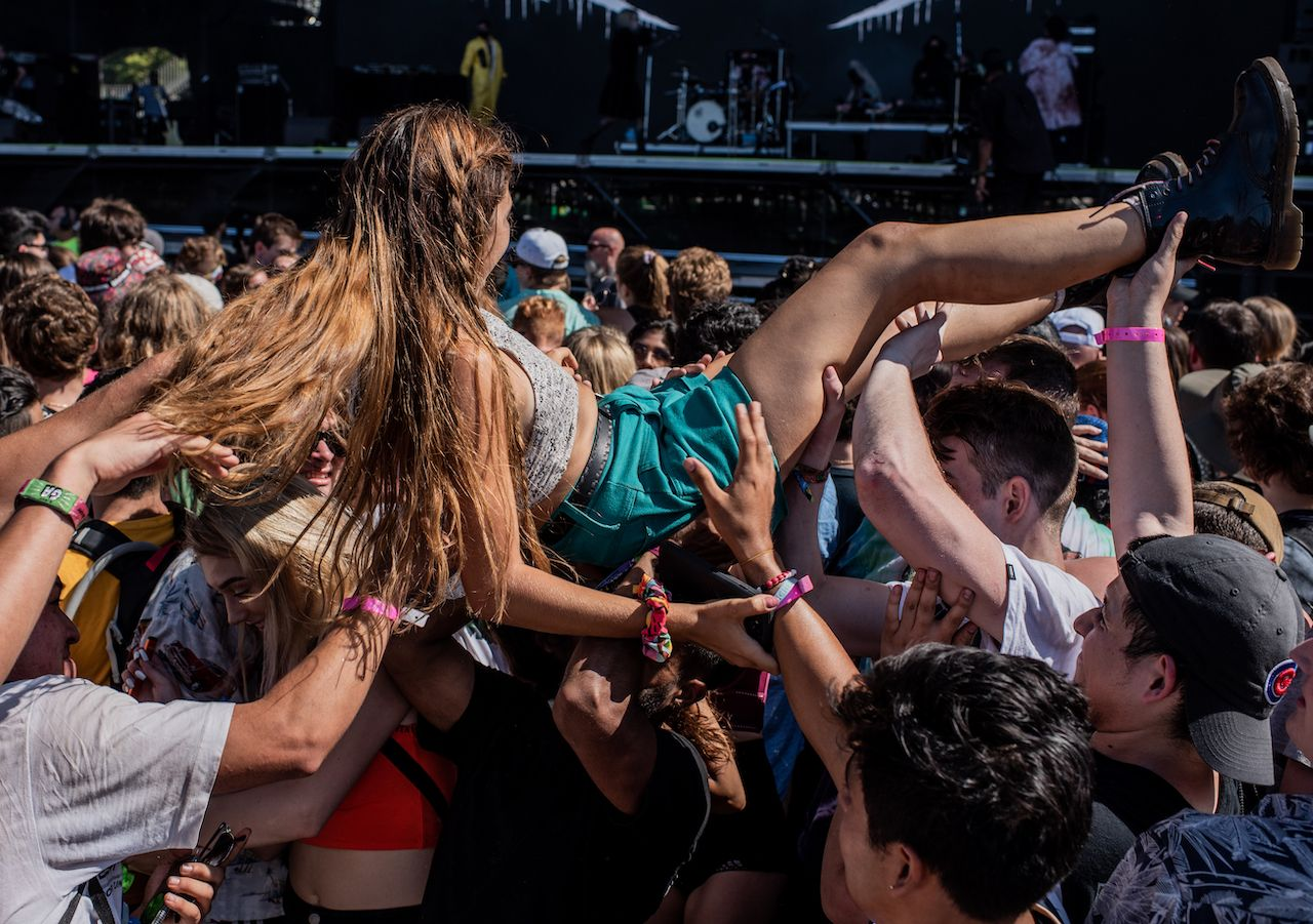 A fan crowd surfs, Lollapalooza